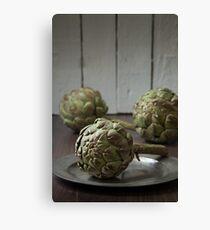 Artichokes in a rustic kitchen Canvas Print