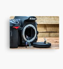 Cleaning a nikon camera Canvas Print