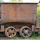 Rusty coppermine carriage by Arie Koene