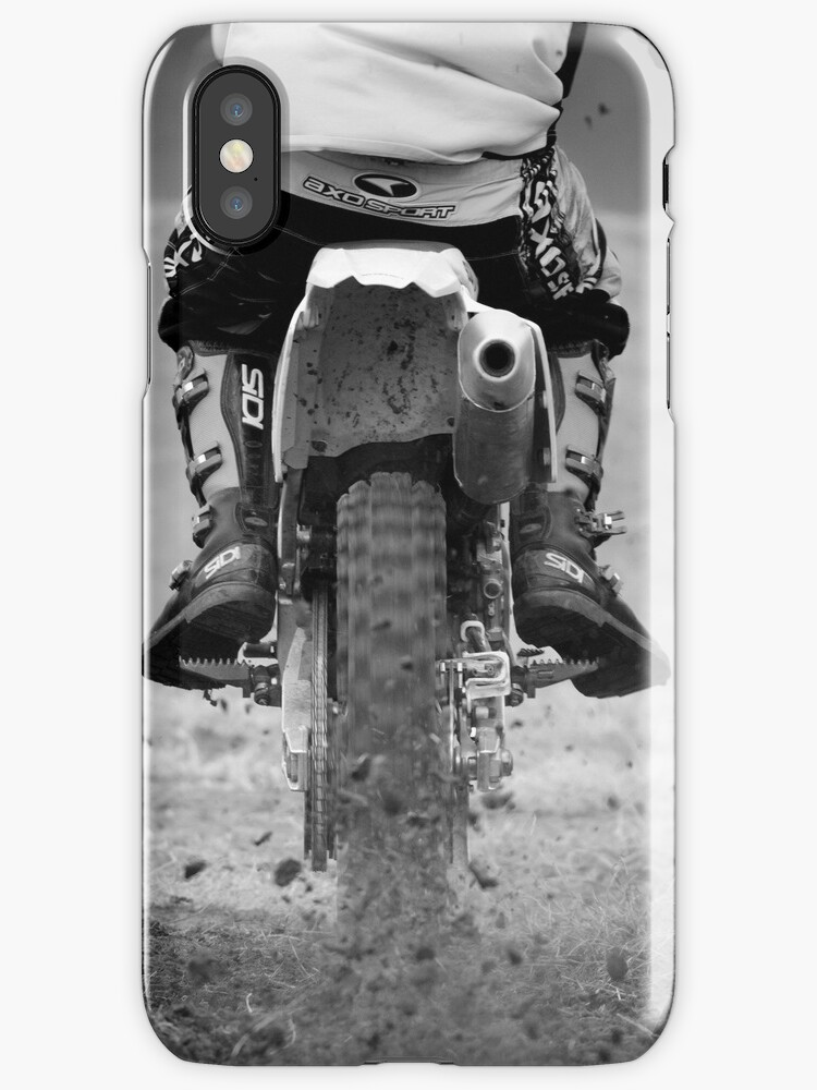 Moto x motorcycle kicking up the dirt by Martyn Franklin