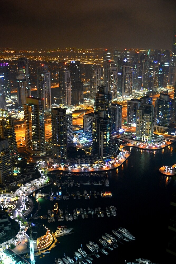 Photography of tall buildings, skyscrapers from Dubai at night. United Arab Emirates. by oanaunciuleanu