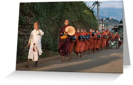 Buddhist Monks with bowls collect food donation for their meal by PhotoStock-Isra