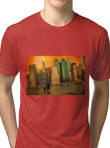 Father and son holding hands watching sunset over the shadows of Manhattan Tri-blend T-Shirt