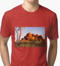 Sunset colours on the Devil's Marbles and ghost-gum Tri-blend T-Shirt