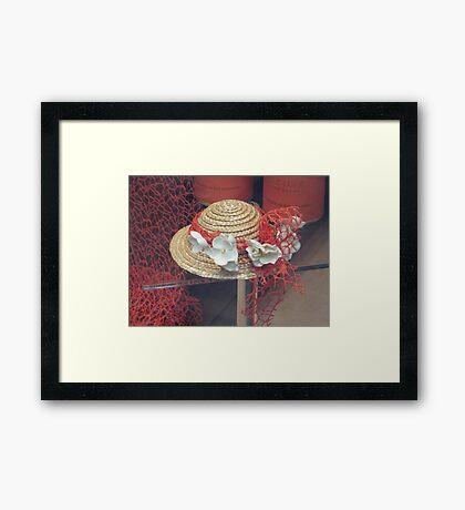 A decorative little straw hat Framed Print