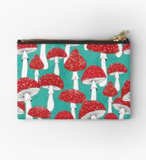 Red mushrooms on turquoise blue Studio Pouch