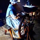 Colonial Woman Spinning by Susan Savad