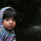 Boy at Cariacu waterfall by Istvan Hernadi