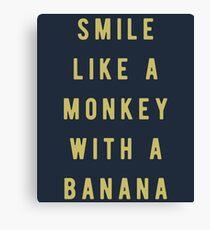 Smile like a monkey with a banana Canvas Print