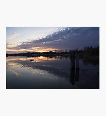 Sunset Sentinels - Three Pillars Guarding the Sundown Reflections Photographic Print