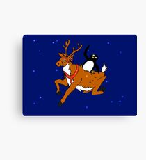 Penguin flying with reindeer Canvas Print