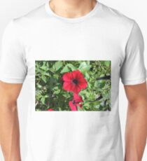 Red flowers and green leaves, natural background. T-Shirt