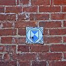 """Red Brick Wall with sign """"Memorial"""" (Historic memorial) in Germany by Remo Kurka"""