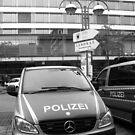 German Mercedes Police Car in front of Russian signboard by Remo Kurka