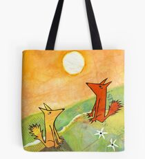 two dogs on a green hill Tote Bag