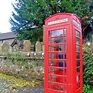 Call Home - Home Call, Red Royal Phone Booth, at a grave yard, cemetery  by Remo Kurka