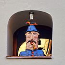 Policemen figure. Seen in Poland at an old house in Torun`s old city centre by Remo Kurka