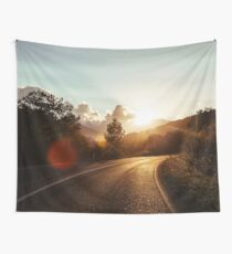 Road at sunset Wall Tapestry