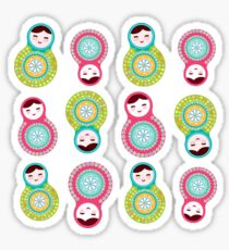 Pink and green matryoshka on white background Sticker