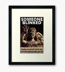 SOMEONE BLINKED Framed Print