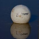 Volleyball Floating in the Muddy Water by Buckwhite