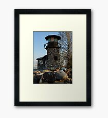 old lighthouse at sunset among the trees Framed Print