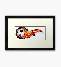 Soccer ball on fire Framed Print