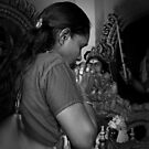 In prayer to her gods ~ Sri Mariamman Temple, Singapore, Malaysia by Lucinda Walter