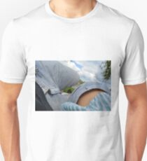 Couple lying on a blanket in the park at a picnic. Unisex T-Shirt