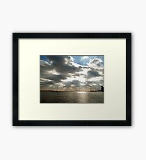 Rays over water Framed Print