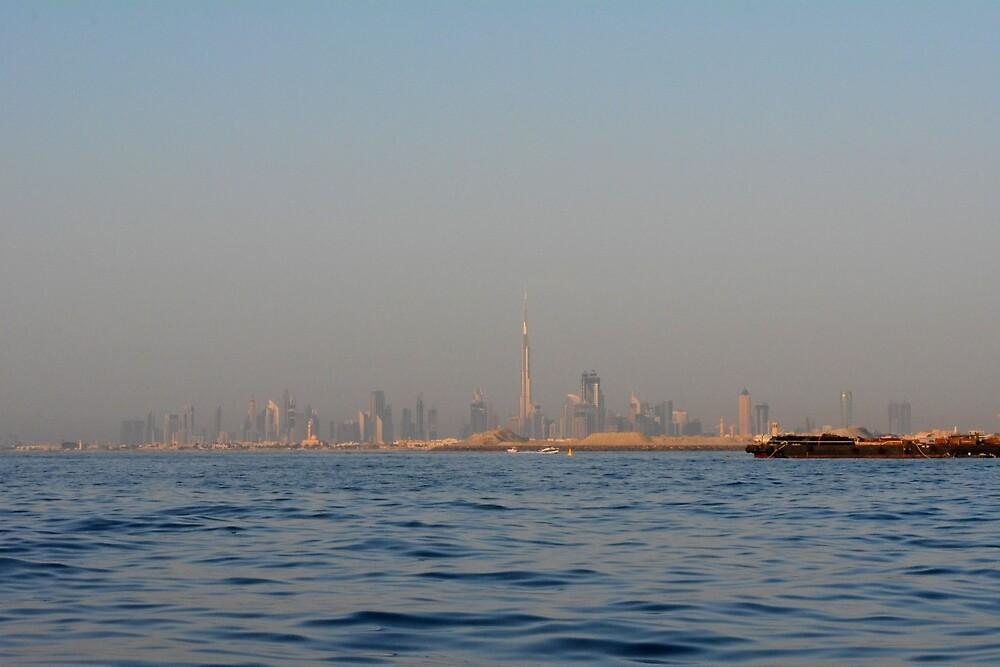 Skyline of Dubai buildings seen from the sea. by oanaunciuleanu