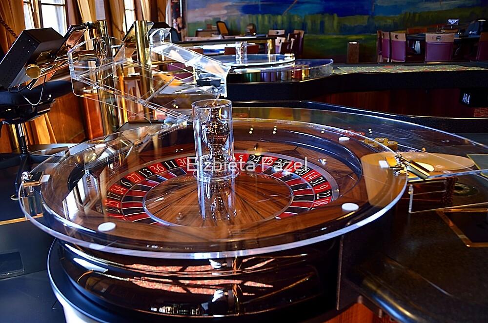 Roulette Table in Casino by Elzbieta Fazel