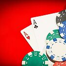 Pair of aces and chips on a red table by gianliguori