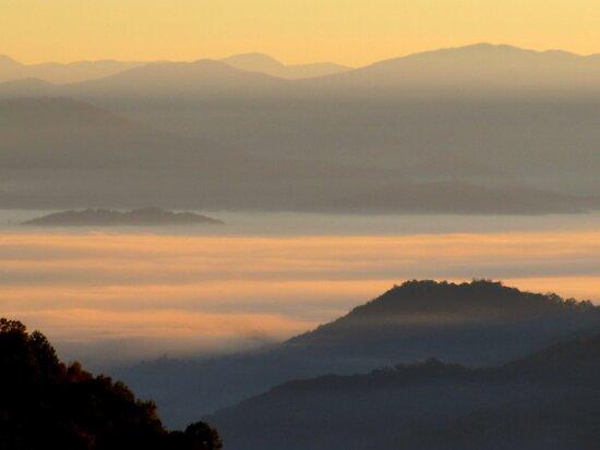 Dawning Sunbeams Fall Across Valley Fog by Jean Gregory  Evans