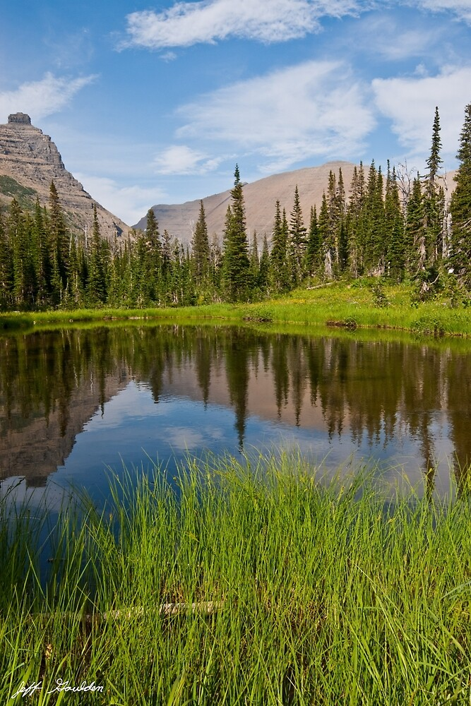 Mountains Reflected in an Alpine Lake by Jeff Goulden