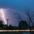 17th Street Car Lights and Lightning Strikes by Bo Insogna