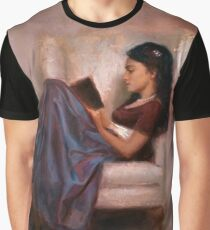Portrait of woman reading a book in a comfy chair Graphic T-Shirt