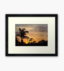Fast Moving Clouds at Sunset Framed Print