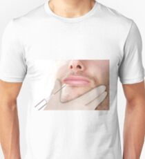 Doctor In glove giving Botox Injection on lips of a man T-Shirt