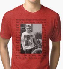 Ryan Gosling wearing a T-shirt of Macaulay Caulkin wearing a T-shirt of Ryan Gosling  Tri-blend T-Shirt