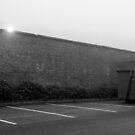 Car park in mist by Rhys Herbert