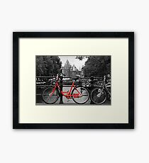 Red Bicycle By The Canal  Framed Print