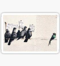 Banksy 'Migrants go home' graffiti art. Sticker