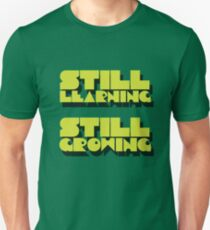 still learning still growing - banksy quote T-Shirt