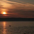 Sea kayaking at sunset by ClaireWroe