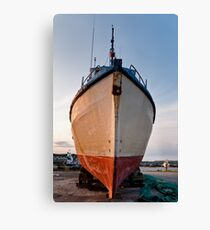 Fish trawler on land during  Canvas Print