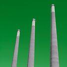 Energy - Three Smoke Stacks on a Green Background by Buckwhite