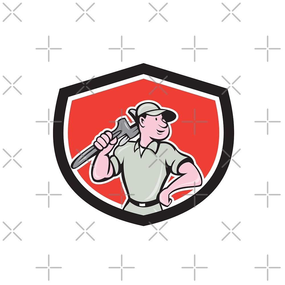 Plumber Holding Wrench Shield Cartoon by patrimonio