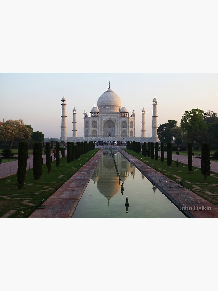 The Taj Mahal and reflective pool at dawn. by JohnDalkin