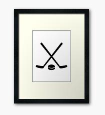 Hockey sticks puck Framed Print